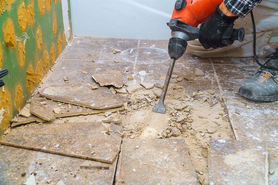 removing old tiles using jackhammer